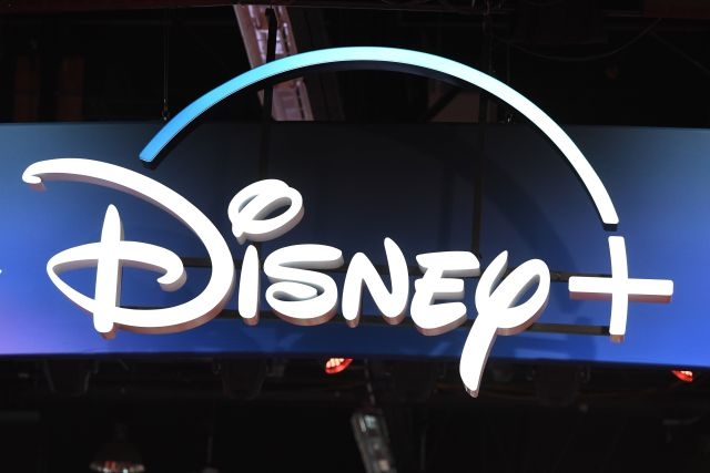 """(FILES) In this file photo taken on August 23, 2019 a Disney+ streaming service sign is pictured at the D23 Expo, billed as the """"largest Disney fan event in the world,"""" at the Anaheim Convention Center in Anaheim, California. - A big launch for the Disney+ streaming service on November 12, 2019 was marred by glitches which prevented many customers from accessing the on-demand television service.After a series of posts on social media from users unable to watch, Disney acknowledged the problem, saying it was the result of strong demand for the service launched in the United States and Canada. (Photo by Robyn Beck / AFP)"""
