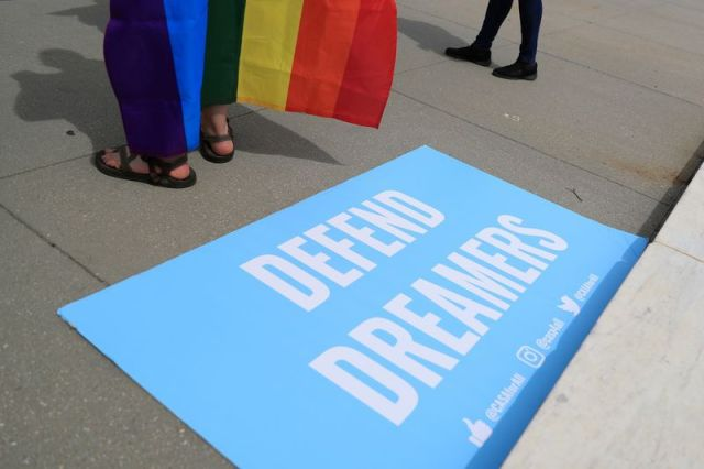 FILE PHOTO: A sign in support of DACA Dreamers lies at the steps of the U.S. Supreme Court after the court declined to hear a Trump administration challenge to California's sanctuary laws, in Washington, D.C., U.S., June 15, 2020. REUTERS/Tom Brenner
