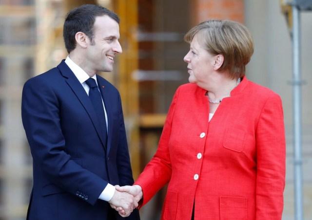 El presidente francés Emmanuel Macron y la canciller alemana Angela Merkel en Berlin, el 18 de abril de 2018 (REUTERS/Hannibal Hanschke)