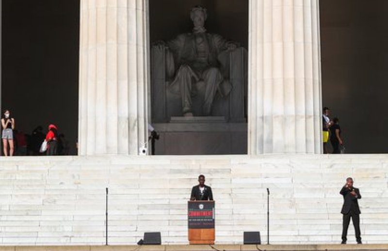 Ty Hobson-Powell, a teenage prodigy who earned a college degree and master's degree at the age of 19 and is now the Founder and Director of Policy for Concerned Citizens DC, speaks to protesters gathered at the Lincoln Memorial on 28 August 2020 (REUTERS / Tom Brenner)