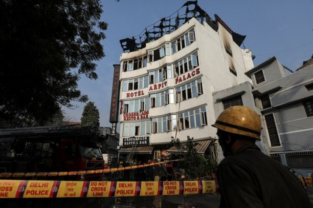 A fireman stands outside the hotel where a fire broke out in New Delhi, India, February 12, 2019. REUTERS/Anushree Fadnavis