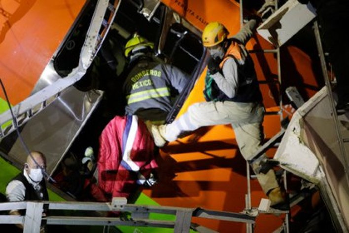 Rescuers work at a site where an overpass for a metro partially collapsed with train cars on it at Olivos station in Mexico City, Mexico, May 3, 2021. Picture taken May 3, 2021. REUTERS/Luis Cortes