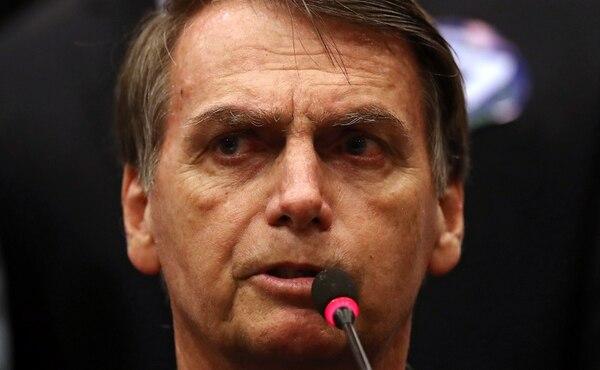 Jair Bolsonaro durante una conferencia de prensa el 11 de octubre (Reuters/ Ricardo Moraes)
