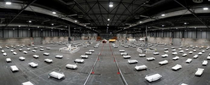 Beds are prepared for coronavirus patients at a military hospital set up at the IFEMA conference centre in Madrid, Spain, March 21, 2020. Picture taken March 21, 2020. Comunidad de Madrid/Handout via REUTERS THIS IMAGE HAS BEEN SUPPLIED BY A THIRD PARTY. NO RESALES. NO ARCHIVES