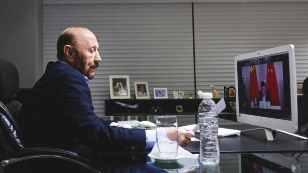 Gildo Insfran en reunión por zoom con el PC Chino