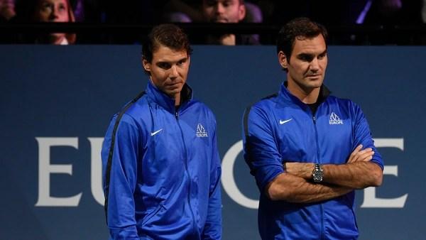 AFP PHOTO / Nadal y Federer jugaron juntos en dobles el año pasado