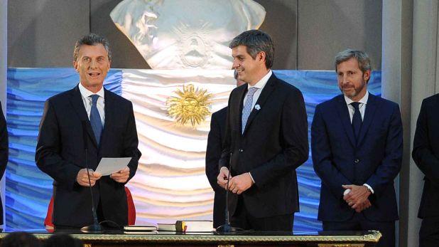 El ex presidente Mauricio Macri junto a Marcos Peña y Rogelio Frigerio