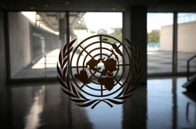 FILE PHOTO: The United Nations logo is seen on a window in an empty hallway at United Nations headquarters during the 75th annual U.N. General Assembly high-level debate, which is being held mostly virtually due to the coronavirus disease (COVID-19) pandemic in New York, U.S., September 21, 2020. REUTERS/Mike Segar