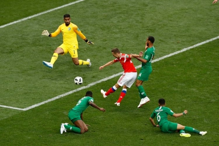 Russia's Denis Cheryshev, center, scores his side's second goal during the group A match between Russia and Saudi Arabia which opens the 2018 soccer World Cup at the Luzhniki stadium in Moscow, Russia, Thursday, June 14, 2018. (AP Photo/Darko Bandic)