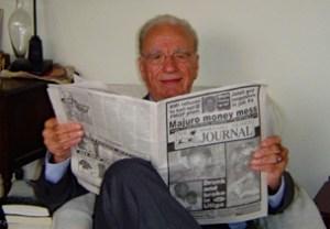 Media tycoon Rupert Murdoch reads a copy of the Marshall Islands Journal in Sydney, Australia. Photo: Karen Earnshaw