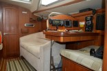 The nav station and comfy starboard settee.