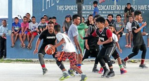 A high-octave game at SGT Solomon Sam Basketball Court between Marshall Islands Middle School and a team from Pohnpei. Photo: Hilary Hosia of the Marshall Islands Journal