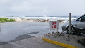 Water splashes over the coral wall at PII's gas station near the bridge. Photo: Karen Earnshaw