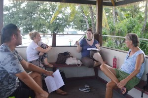 Amy critiques one of the stories with Jerry, Emily, and Lise of the Majuro Lagoon Writers. Photo: Karen Earnshaw