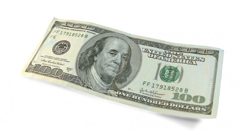 a-hundred-dollar-bill-isolated-on-a-white-background