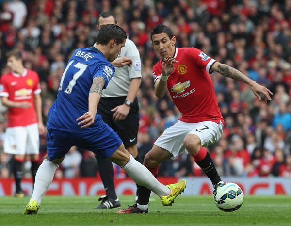 Angel Di Maria Tries to Beat Muhamed Besic. Image: Getty.