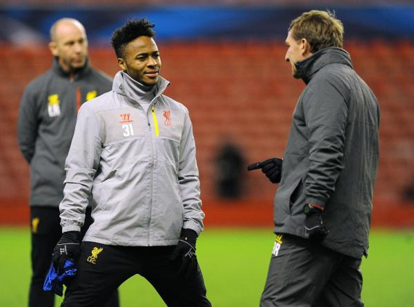 Brendan Rodgers and Raheem Sterling Chart During Training Ahead of Basel. Image: LFC via Getty.