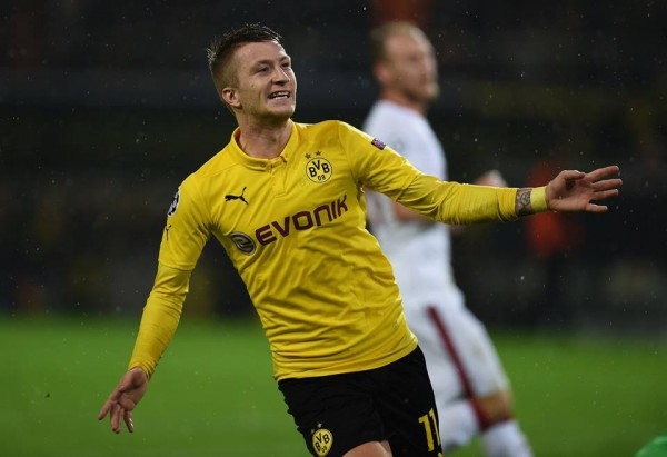 Marco Reus Celebrates Scoring for Dortmund in a Champions League Game This Season. Image: Getty.