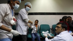 Doctors attend to a boy who was injured during an earthquake, at a trauma center in Kathmandu