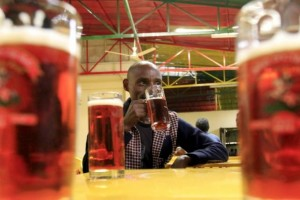 Customer drinks beer at the St. George brewery's public pub in Ethiopia's capital Addis Ababa