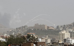 Rockets fly from missile base which was hit by an air strike in Yemen's capital Sanaa