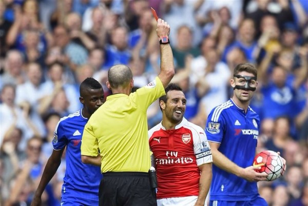 Santi Cazorla Receives His Second Yellow Card for a Foul on Cesc Fabregas. Image: Getty.