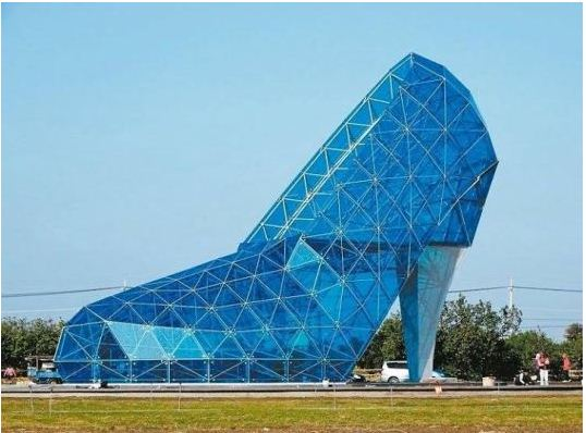 cd81345ce309 The fashionable church building is located in the Southwest Coast Scenic  Area in Taiwan. The huge high-heel shoe is 17m high and 11m wide