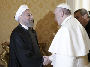 Pope Francis welcomes Iranian President Hassan Rouhani, left, on the occasion of their private audience at the Vatican,Tuesday, Jan. 26, 2016. Iran's president has paid a call on Pope Francis at the Vatican during a European visit aimed at positioning Tehran as a potential top player in efforts to resolve Middle East conflicts, including Syria's civil war. (AP Photo/Andrew Medichini, Pool)