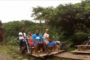 Colombian-villagers-build-motorcycle-powered-carts-to-run-on-train-tracks