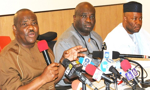 FROM LEFT: GOV NYESOM WIKE OF RIVERS STATE; GOV OKEZIE IKPEAZU OF ABIA STATE AND THE SENATE MINORITY LEADER, SEN GODSWILL AKPABIO, DURING THE NEWS CONFERENCE ON THE PEOPLES DEMOCRATIC PARTY'S (PDP) NATIONAL CONVENTION IN PORT-HARCOURT.