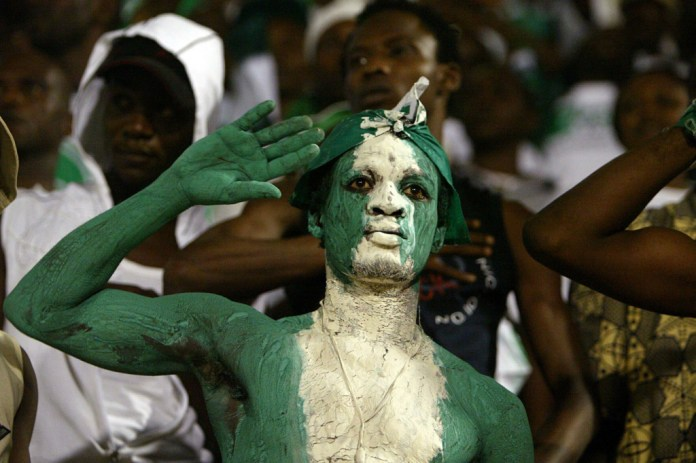 Fans cheer on the Nigerian team during their World Cup qualifier soccer match against Algeria in Oran, Algeria September 4, 2005. Three goals in the last eight minutes ensured Nigeria kept alive their chances of World Cup qualification with a 5-2 away win over Algeria on Sunday.