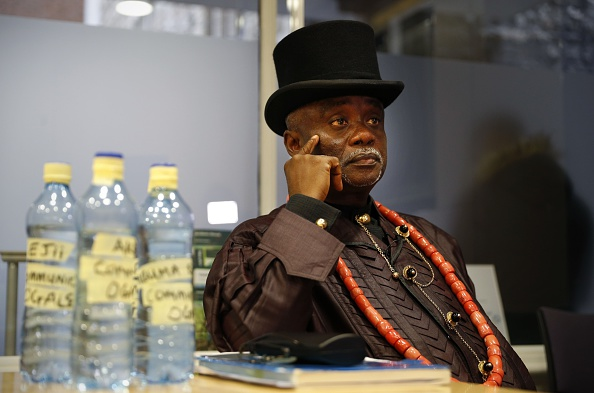 Bottled water samples stand on a table as Nigerian tribal king Emere Godwin Bebe Okpabi speaks during an interview in central London on November 21, 2016. Britain's High Court will on November 22, begin to hear arguments on whether the English Courts can hear two legal claims on behalf of over 40,000 Nigerians against Royal Dutch Shell and its Nigerian subsidiary, Shell Petroleum Development Company of Nigeria (SPDC), in relation to environmental damage caused to two separate communities in the Niger Delta. / AFP / ADRIAN DENNIS / TO GO WITH AFP STORY by Alice RITCHIE (Photo credit should read ADRIAN DENNIS/AFP/Getty Images)