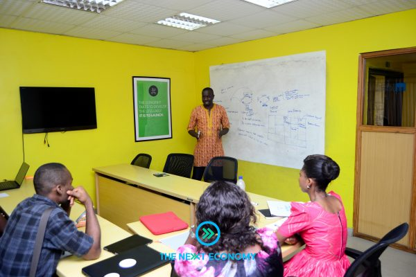 Femi  Longe ( Founder & Director CCHub) directing the 'Business Modelling' class.