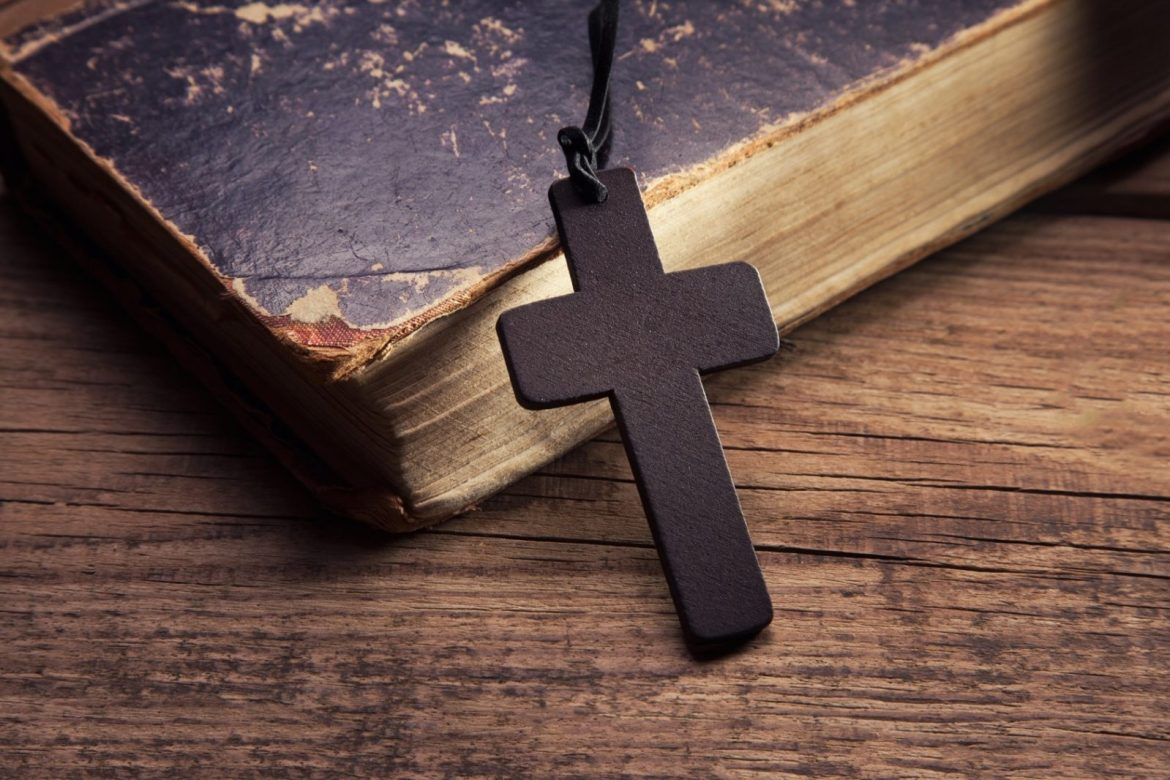 bible and cross - 'The bible should be thrown away' – Nigerian lady drags God on Twitter