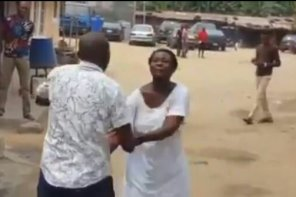 Drama As Mad Woman Hits Pastor In The Head While He Was Trying To Heal Her In Lagos (Video)