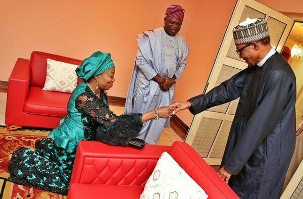 Lagos State first lady, Bolanle Ambode kneels down to greet ...