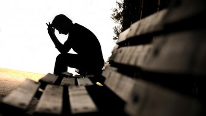 sad man silhouette on bench - What Nigerians Are Saying After Unemployed Graduate Of Three Years Rejected A Driving Job