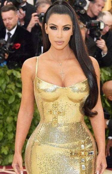 actress moyo lawal hints at saving for surgery to get a kim kardashian body - Reality TV star Kim Kardashian slammed with a $100 million lawsuit over her Kimoji app