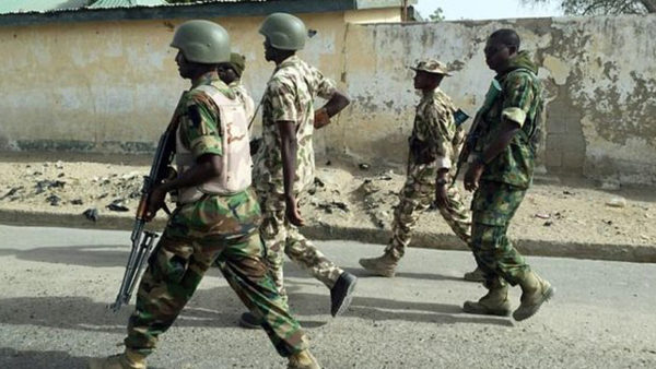 Foreigner orders soldiers In Lagos to beat young lady
