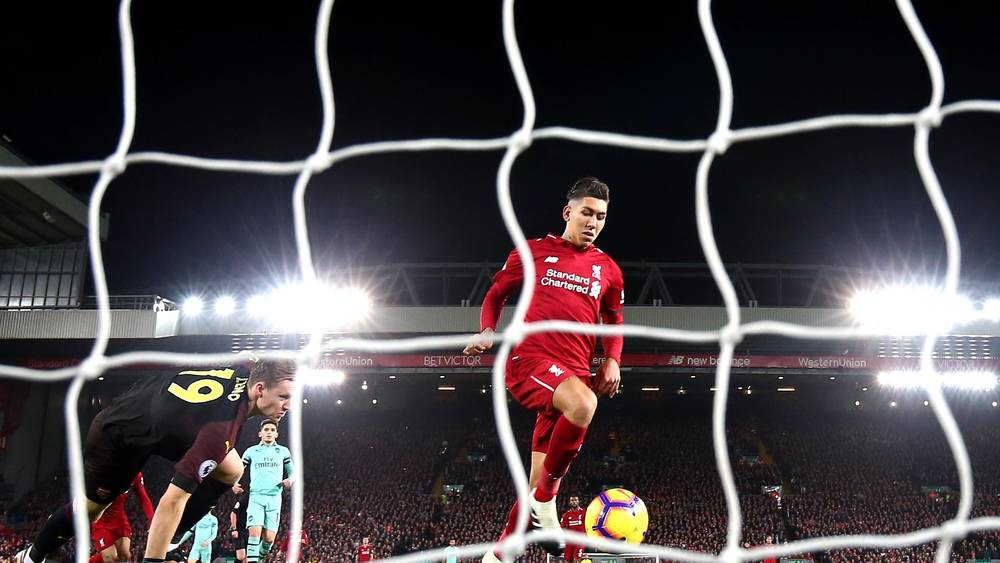 Liverpool player while scoring a goal