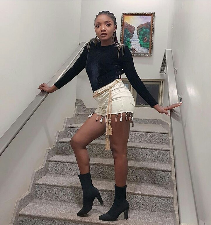 singer simi slams a fan who tried to compare her with teni - Lagos Building Collapse: Simi Blows Hot