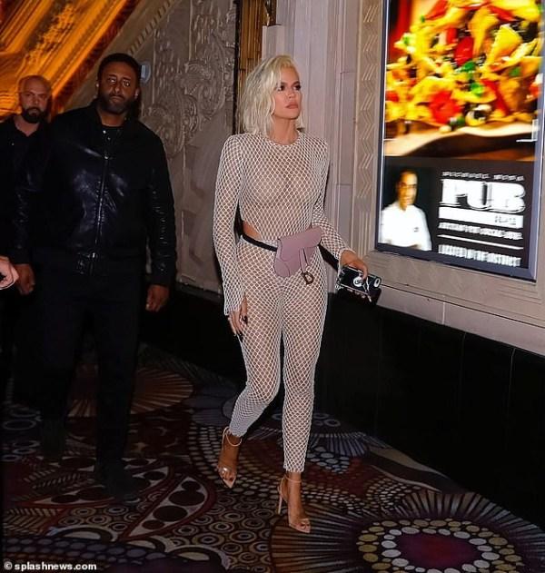 5c8673564f7ba - [Photos]: Khloe Kardashian bares her unbelievable figure in fishnet jumpsuit