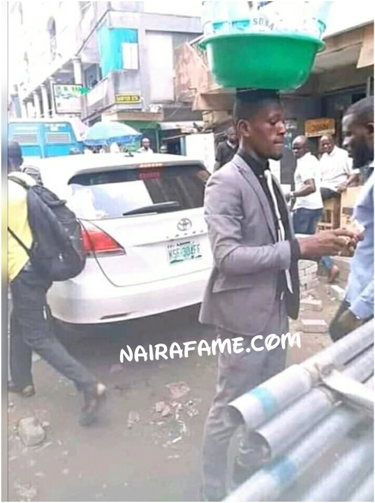 9166850 1555051854321 jpeg76987f2bba8ca069913bc208c9950ad6 - Wonders!!! Man in Suit Hawks Purewater [See Pictures]