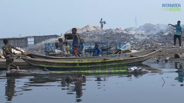 Children play in abandoned boats