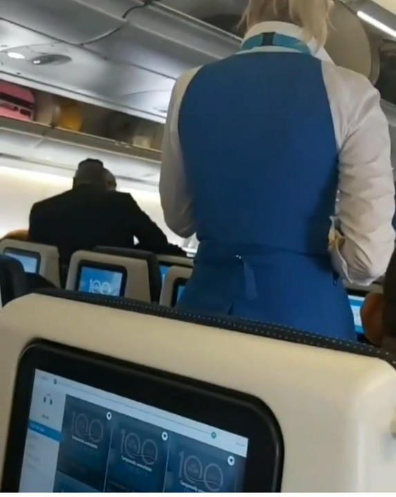 The elderly Nigerian man shouting at the air hostess