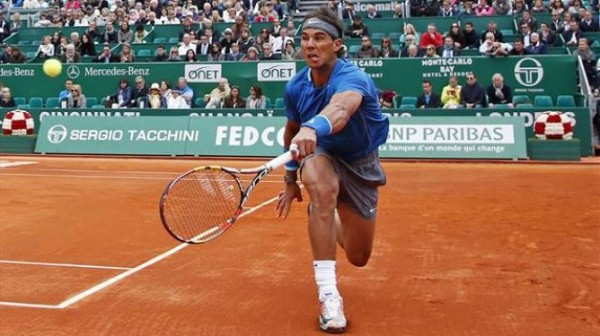 Rafael Nadal Tries a Back-Hand During His Fourth Round Match At the 2014 Monte Carlo Open.