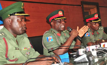 PUBLIC RELATIONS OFFICER, OFFICE OF THE CHIEF OF ARMY STAFF, LT.-COL. AMINU ILIYASU; DIRECTOR, ARMY PUBLIC RELATIONS, BRIG.-GEN. OLAJIDE LALEYE AND CHIEF OF STAFF, DIRECTORATE OF ARMY PUBLIC RELATIONS, AT A NEWS CONFERENCE ON ARMY OFFICERS CONFERENCE IN ABUJA ON FRIDAY