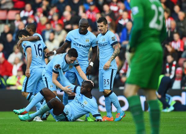 Yaya Toure Celebrates With Team-Mates After Doubling City's Advantage. Image: Getty.