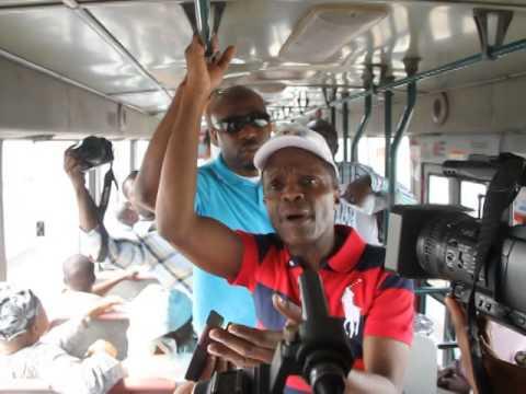 APC Vice preesidential candidate, Yemi Osinbajo standing in a bus in Lagos