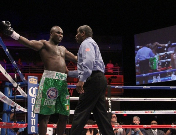 Kayode Gesturing to the Referee He Wasn't Hurt During His WBA Heavyweight Title Fight With Luis Ortiz. Image. WBA/Sumio Yemada.